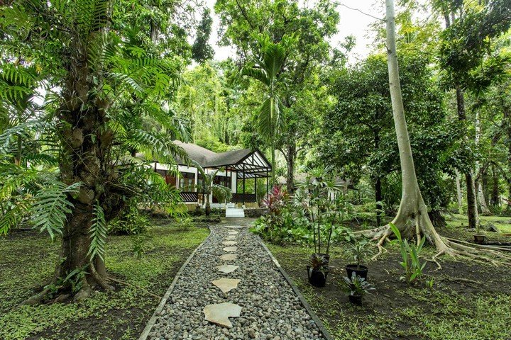 Murex Manado Resort bungalow in tropical garden