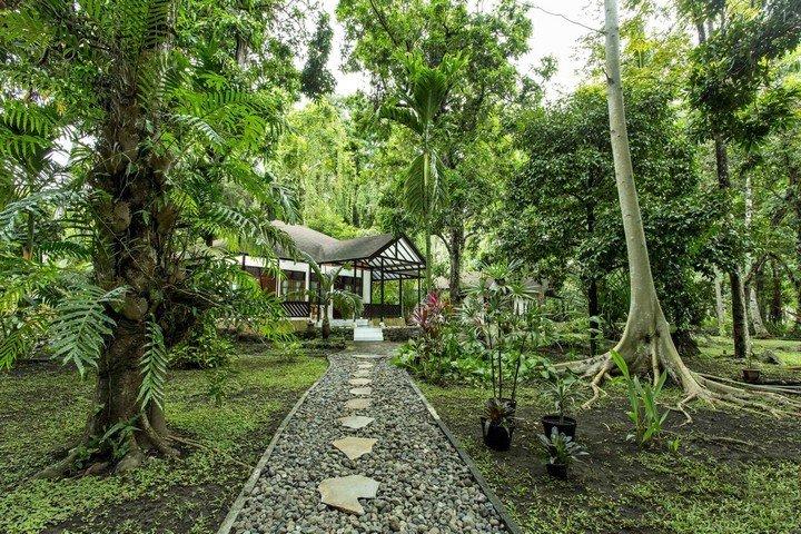 Murex Manado Resort bungalow in tropical garden