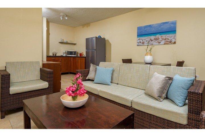 1 slaapkamer appartement woonkamer - Buddy Dive Resort