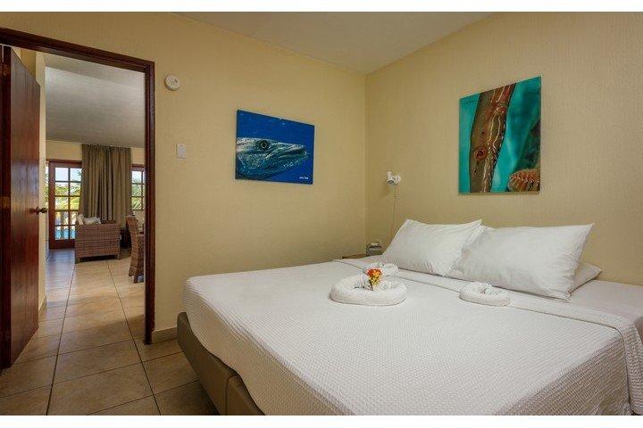 1 slaapkamer appartement slaapkamer - Buddy Dive Resort
